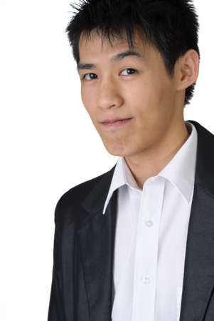 Closeup portrait of young Asian businessman with happy expression. photo