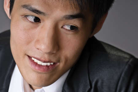 Handsome business man face of Asian, closeup portrait. Stock Photo - 7702501