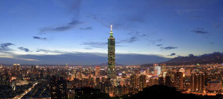 Panoramic city skyline in night with famous 101 skyscraper and buildings in Taipei, Taiwan.