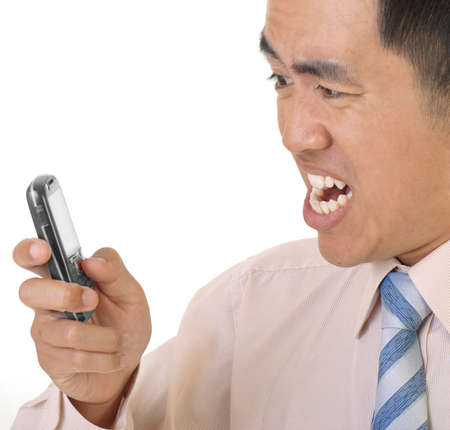 infuriate: Angry executive with telephone, closeup portrait on white background. Stock Photo