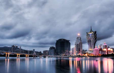 macau: Macao cityscape with famous landmark of casino skyscraper and bridge in night.