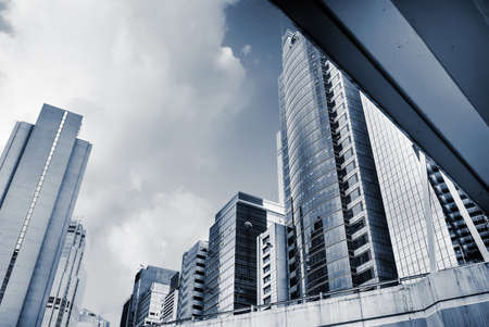 office window view: Modern city skyline with skyscrapers and office buildings. Stock Photo