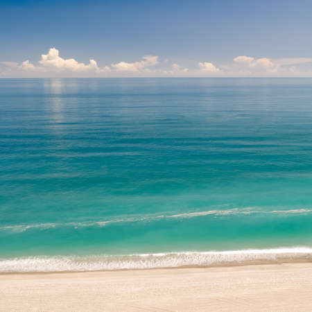 seasides: Beautiful landscape of beach with green water and blue sky. Stock Photo