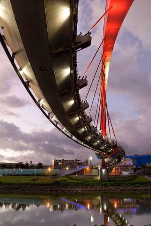 Modern bridge in night in Taipei, Taiwan. Vertical cityscape.