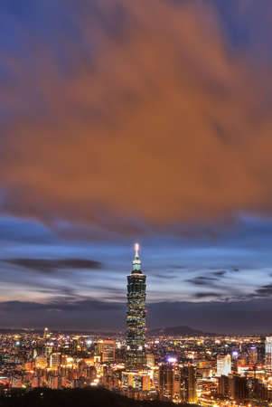 Taipei city night with famous landmark 101 skyscraper under dramatic and colorful  clouds in Taiwan, Asia.
