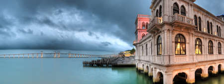 Cityscape of building on dock with beautiful bridge and ocean in Macao, China. Stock Photo