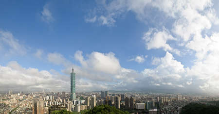 Cloudy cityscape of Taipei with famous 101 skyscraper in Taiwan. Horizontal wide panoramic city scenery. photo