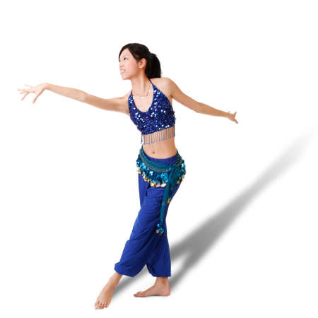 Dancing pose by oriental woman, full length portrait isolated on white background. Stock Photo - 7805174