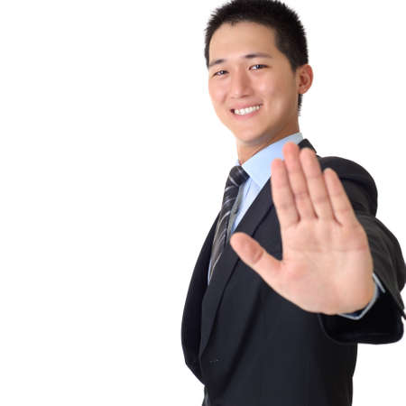 Happy Asian business man with reject gesture and smiling expression, closeup portrait with copyspace on white. photo