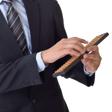 calculator chinese: Business man use abacus of Chinese traditional financial tool.