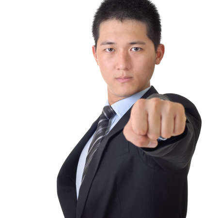 Confident Asian business man with fist, closeup portrait on white background. photo