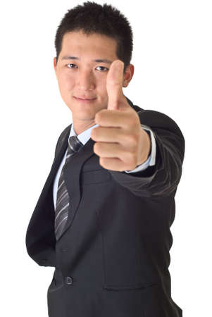 Handsome business man give you an excellent gesture. Stock Photo - 7904060