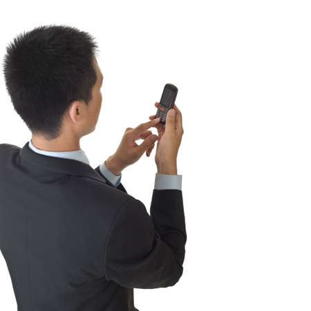 Business man holding cellphone with copyspace on white. photo