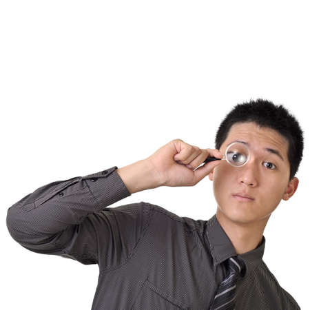 Business man discover concept by holding magnifier on one eye. photo