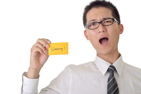 Asian business man show wrong word on yellow card. Stock Photo - 7904061