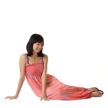 Asian woman with pleasure sit on ground isolated on white. photo
