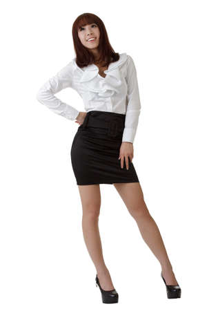 Happy business woman portrait of Asian standing and posing against white. 스톡 콘텐츠