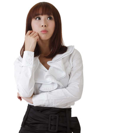 Confused business woman, oriental office lady against white. Stock Photo - 7904089