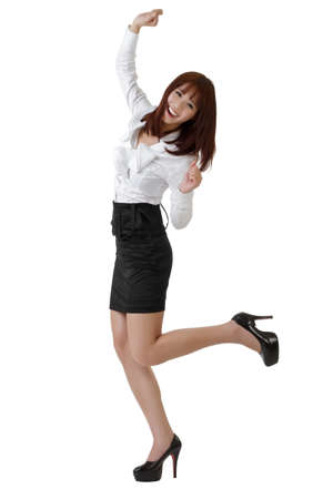 Happy business woman dancing, full length portrait isolated on white.