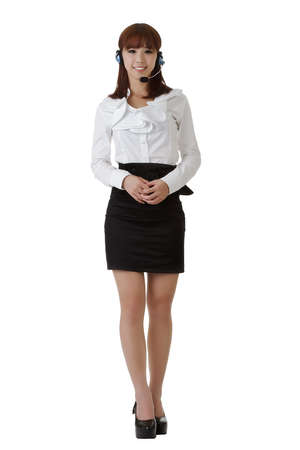 bright center: Attractive Asian secretary smiling, full length portrait isolated on white.