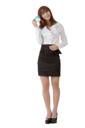 east espresso: Happy office lady holding a cup of coffee with smiling expression isolated on white.