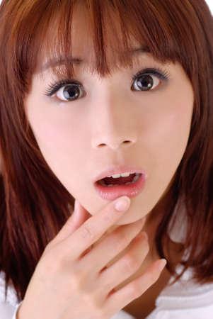 Expression of surprise, closeup portrait of Asian businesswoman face. photo