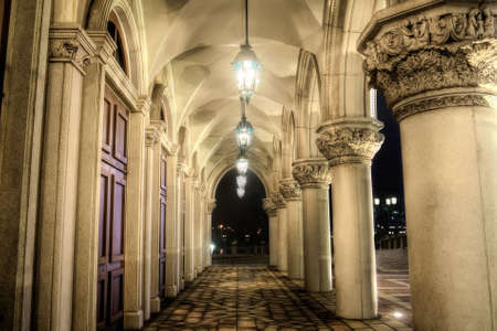 Old corridor in yellow color with lamp in night. photo