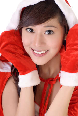 Asian beauty with Santa Claus dress, closeup portrait on white. Stock Photo - 7943431