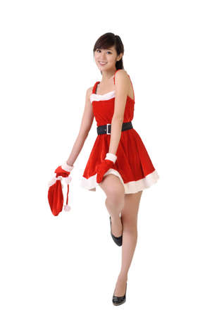 Beautiful Christmas beauty posing with joy, full length portrait isolated on white. Stock Photo - 7943399