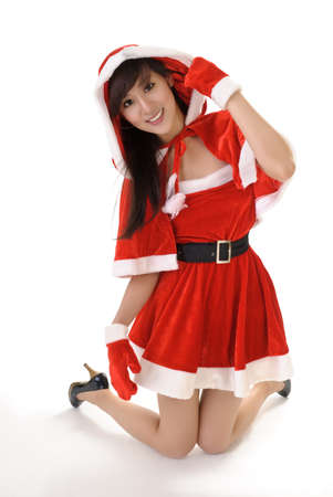 Seductive Christmas beauty of Asian kneel on studio white ground with smile. Stock Photo - 7943406