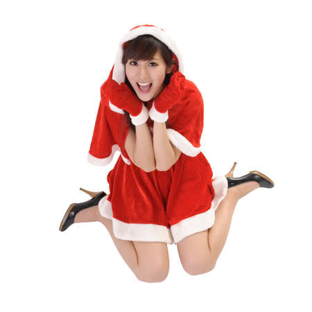 Happy Christmas girl with smiling expression on face sit on studio white ground. Stock Photo - 7943401