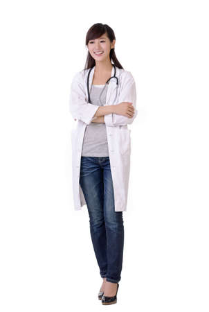Happy smiling young medical doctor woman walking, isolated over white. Stock Photo - 7943434