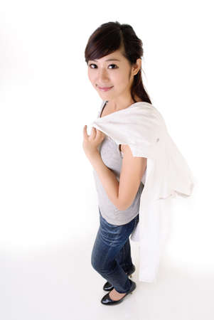 off shoulder: Young medical doctor woman of Asian off work put coat on shoulder. Stock Photo