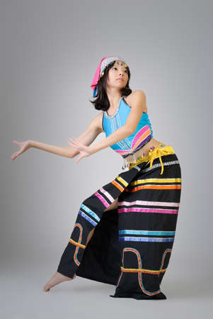 cultural and ethnic clothing: Attractive Chinese dancer in colorful traditional dress, Dai ethnic.