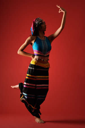 Mysterious traditional dancing of Chinese minority nationality girl. photo