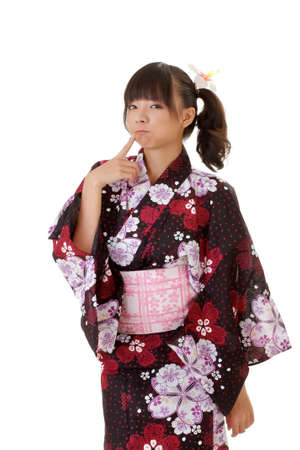 Adorable Japanese girl with funny expression in traditional clothes. Stock Photo - 7943473