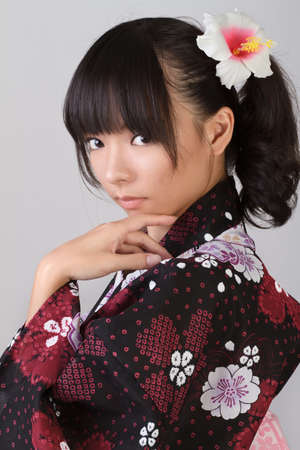 japanese kimono: Mysterious Japanese woman with attractive face, closeup portrait. Stock Photo