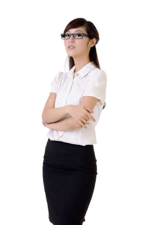 presumptuous: Proud business woman with confident expression against white. Stock Photo