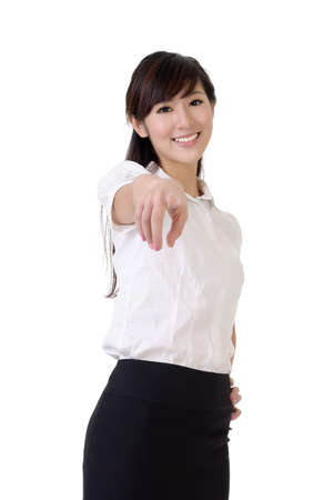 eastern asian: Happy business woman point at you with pleasure against white.