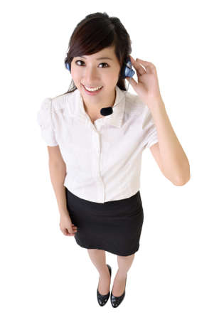 Full length portrait of Asian customer service isolated on white.