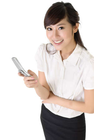 mobile office: Happy business woman using cellphone with copyspace on white.
