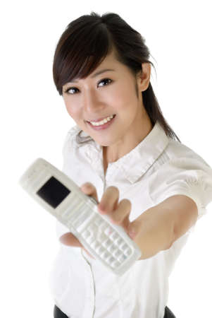 Smiling business woman showing cellphone at you on white background. photo