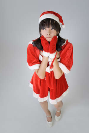 Cute Christmas girl with funny expression against gray background. Stock Photo - 8006717