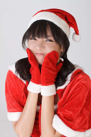 Adorable Christmas girl with funny face and happy expression. photo