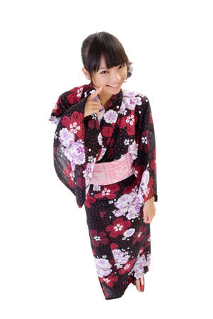 Japanese kimono girl: Sweet japanese girl with traditional clothes, full length portrait isolated on white.