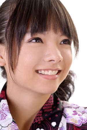 Smiling japanese girl face, closeup portrait of Asian woman in traditional clothes. photo