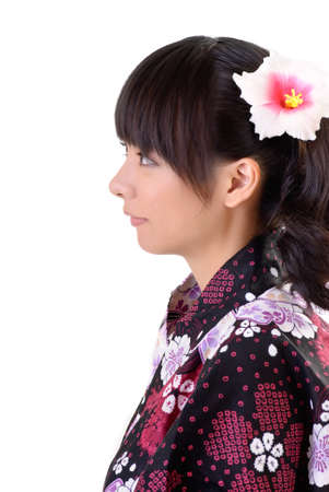Beautiful japanese woman with traditional clothes and flower on head with copyspace on white. Stock Photo - 8068352