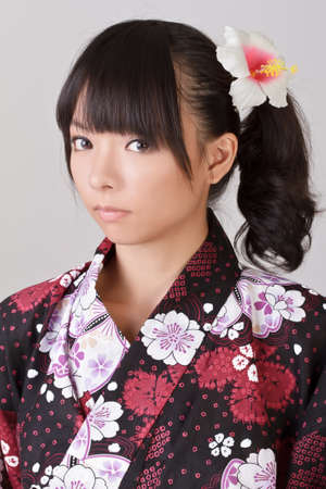 Young attractive girl of Asian on japanese traditional clothes with cool eyes and sight. Stock Photo - 8068359
