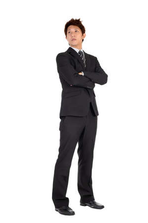 Young executive of Asian, full length portrait isolated on white. Stock Photo