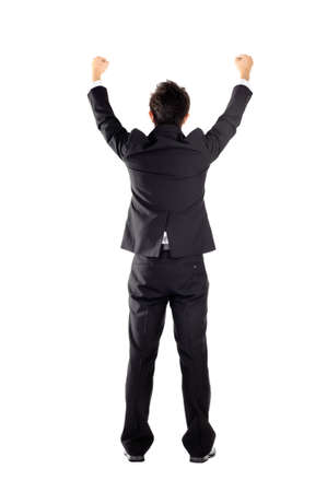 Successful business man raising hand, isolated on white. photo